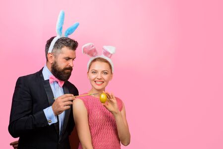 Easter family. Easter eggs. Holidays. Family celebrate Easter. Couple painting eggs for Easter. Happy couple with bunny ears. Bunny couple. Happy holidays. Happy couple painting eggs. Bunny ears