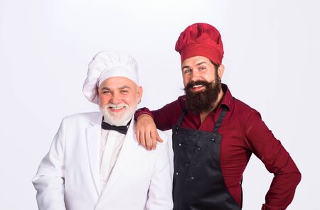 Two chefs on kitchen. Chefs in uniform. Healthy food. Chief cook and professional culinary. Professional cook men. Chef. Cook or baker men. Chefs ready to cook. Professional culinary