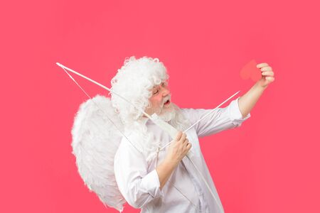 Cupid in valentine day. Cupid throws love arrow with bow for valentine day. Male angel with bow and arrow. Valentines day cupid. Cupid angel with bow and arrows. Valentines Day concept. Arrow of love