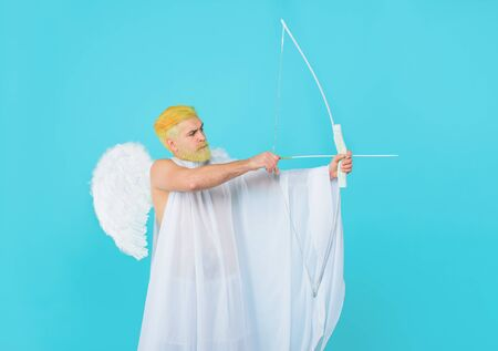 Symbol of love. Happy Valentines Day. God of love. Cupid. Amour. Cupid with bow. February 14. Cupid angel with bow and arrows. Serious man in angel costume. Valentines day angel. Cupid shoot with bow