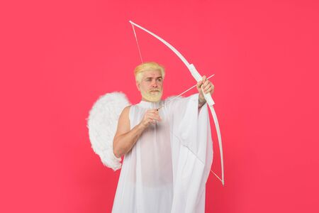 God of love. Cupid. Amour. Cupid with bow. February 14. Cupid angel with bow and arrows. Man in angel costume. Valentines day angel. Cupid shoot with bow. Symbol of love. Happy Valentines Day