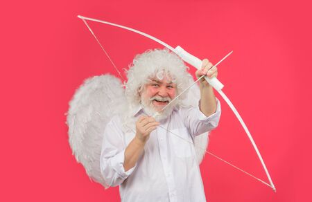 Valentines cupid. Angel man with white wings. Cupid with bow and arrows. Love concept. Valentine angel. Handsome male angel Cupid. Bearded man with angel wings. Valentines day card. Valentines Day