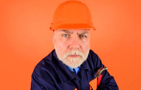 Portrait of repairman in hard hat. Business, building, industry, technology. Builder in hard hat. Engineers working. Advertising. Funny repairman. Hard hat. Repairment tools