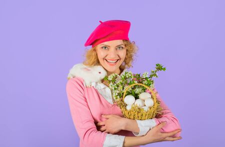Easter day. Easter basket. Happy woman with white rabbit and basket. Girl holds little bunny. Beautiful girl with white rabbit. Easter basket. Easter Bunny. Cute rabbit