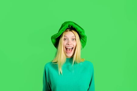 St Patrick's Day. Happy girl in green hat celebrate Patricks Day. Leprechaun. Smiling girl. Green leprechaun. Green hat. Clover. Traditions of Saint Patrick Day. Leprechaun costume. Irish Traditions