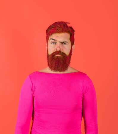 Bearded man with colored hair. Serious man with dyed beard and hair. Hipster with pink hair. Hairstyle. Hairstylist. Advertising and barber shop concept. Man with creative painting hair and hairstyle 版權商用圖片