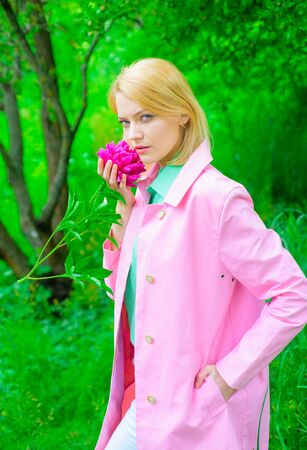 Peony flower. Sensual woman with peony bouquet. Fashion, cosmetic, perfume. Cute woman smelling pink flower. Beautiful girl with flower. Romantic girl hold peony flower in park. Woman in park. Spring