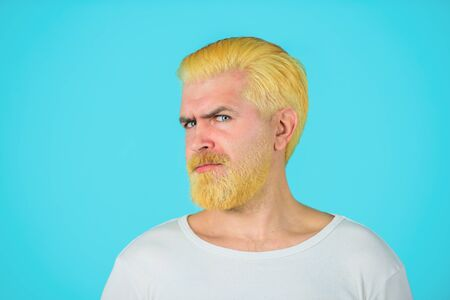 Barbershop. Blond hipster guy. Handsome man with stylish haircut. Bearded man with dyed blonde hair. Modern handsome man with blonde dyed hair. Eccentric man with dyed hair. Coloring of men's hair