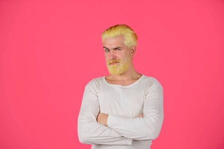 Handsome man with stylish haircut. Bearded man with dyed blonde hair. Blond hipster guy. Modern handsome man with blonde dyed hair. Eccentric man with dyed hair. Coloring of men's hair. Barbershop