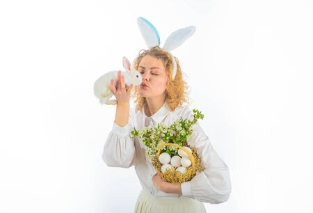 Easter Bunny. Eggs hunt. Easter egg. Rabbit ears. Girl in bunny ears holds basket with eggs and Easter bunny. Religion symbol. Basket with eggs. Spring holiday. Happy Easter day