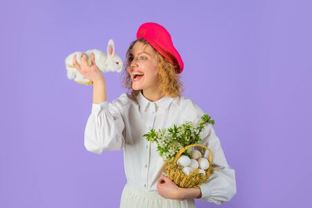 Beret hat. Accessory for woman. French style. Happy Easter day. Tradition of Easter. Basket with eggs. Easter bunny rabbit. Girl in fashionable beret hold basket with eggs and small bunny. Easter egg 版權商用圖片