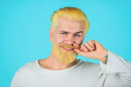 Hairstyle. Hairstylist. Advertising and barber shop concept. Bearded man with colored hair. Man with creative painting hair and hairstyle. Smiling man with dyed beard and hair. Hipster bleached hair