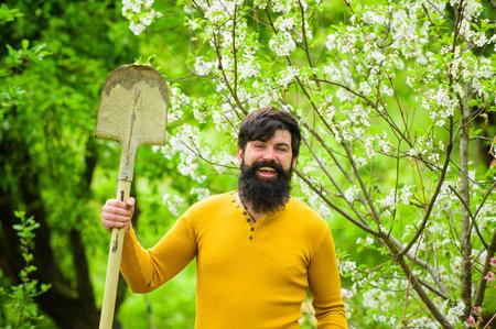 Farm. Smiling man preparing to planting. Gardener work. Spring. Work in garden. Farmer working in garden. Plants. Gardening. Bearded gardener with gardening spade. Work in garden Stok Fotoğraf