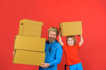 Concept of courier and messenger service. Delivery person. Delivery service. Delivery man and boy with parcel. Kid holds cardboard box. New purchases or delivery from shop. Free shipment, sale
