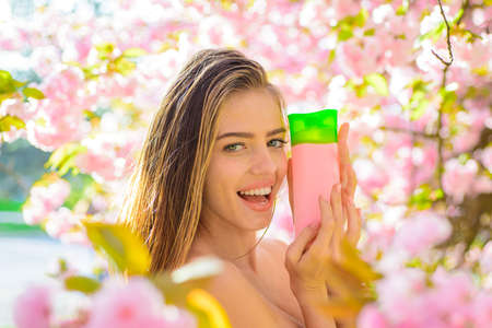 Hair balsam. Woman with cosmetic for hair. Herbal SPA. Shampoo. Cosmetic for hair. Beautiful woman with shampoo or conditioner. Shampoo, balsam, conditioner. Nature herbal cosmetic for hair. Haircare Stok Fotoğraf