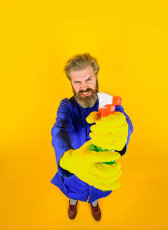 Bearded man with cleaning spray. House clean. Bearded man with broom. Cleaning and disinfection. Professional cleaning. Cleaning service. Clean up. Clearing tools. Household. Housekeeping