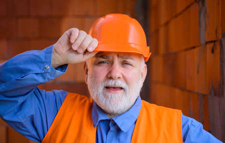 Business, building, industry, technology. Bearded man in suit with construction helmet. Builder in hard hat. Engineers working. Repairment. Portrait mechanical worker. Construction worker in hardhat