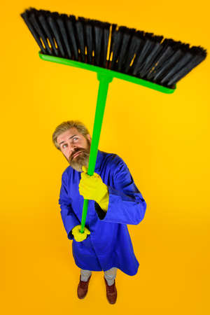 House cleaning. Broom. Bearded man with broom. Cleaning and disinfection toilet. Professional cleaning. Cleaning service. Clean up. Clearing tools. Household. Housekeeping. Besom. Stok Fotoğraf