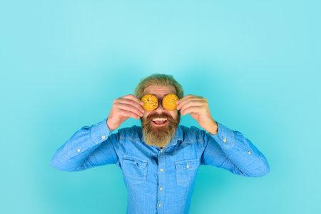 Man with cookie. Homemade cookies. Taste of childhood. Bearded man with cookies. Breakfast or lunch. Sweet cookies. Bakery. Biscuit. Biscuits. Sweet snack Stok Fotoğraf