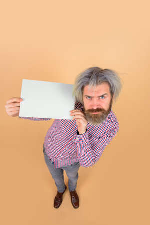 Sale. Discount. Advertising banner. Serious man with blank board. Bearded man shows empty board. Space for your text. Bearded man holds empty board. Advertising board. Copy space for text