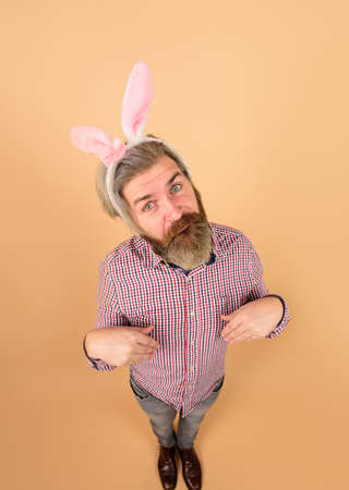 Happy Easter! Man with rabbit ears in full height. Excited man with bunny ears. Easter bunny. Easter day. Easter bunny. Egg hunt. Bunny costume. Sale. Discount. Spring holidays