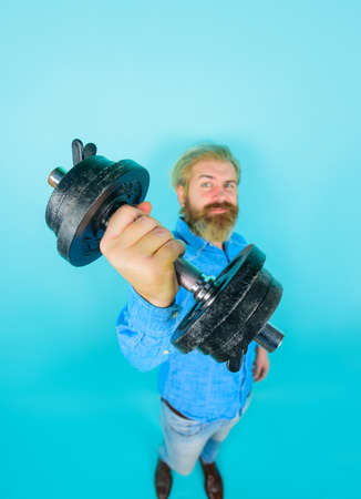 Bearded man with dumbbell. Man with dumbbell during an exercise. Sport. Workout. Fitness. Healthy lifestyle. Stok Fotoğraf