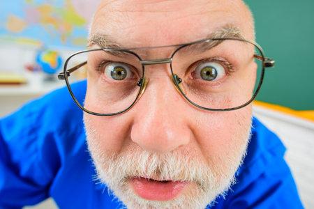 Teacher in glasses. Learning, education, school concept. Back to school. September 1. Teacher prepares lessons in classroom. Teacher. Serious teacher in classroom. Teachers day Stok Fotoğraf