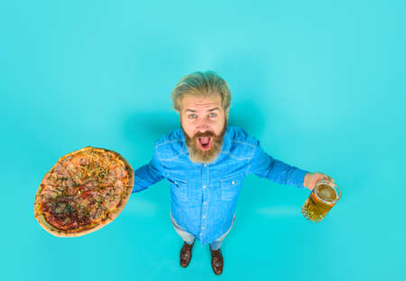 Pizza. Fastfood. Bearded man holds pizza. Man eat fresh pizza. Delicious fast food meal. Italian cuisine concept. Tasty pizza at restaurant. Lunch or dinner Stok Fotoğraf - 162233168