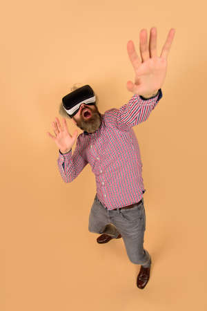 3d goggles virtual reality. Attractive man using virtual reality glasses feeling scary. VR headset. Man using augmented reality eyeglasses. Men using VR headset. Virtual reality goggles. VR glasses Stok Fotoğraf