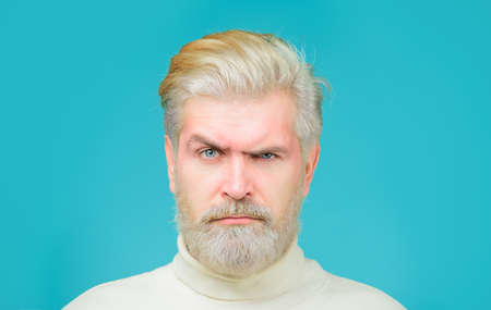 Barbershop concept. Man with bleached hair and beard. Coloring of men's hair. Bearded man with dyed blonde hair. Bearded man with blonde dyed hair Stok Fotoğraf