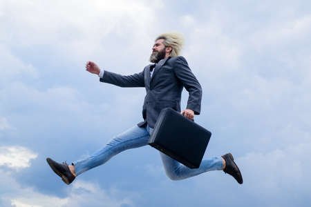 Business. Advertising. Businessman with suitcase. CEO. Businessman in suit outdoor. Business, people and office concept. Bearded businessman with case