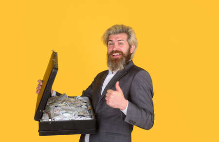Business. Smiling businessman hold case with money. Dollar banknotes. Bills. CEO. Bearded businessman in suit. Stok Fotoğraf - 162233183