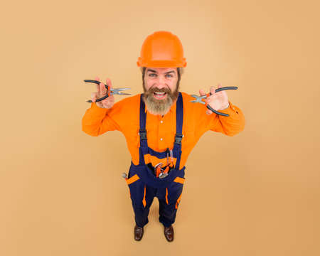 Building. Industry. Builder with repair tools. Bearded man in construction helmet with pliers. Engineers working. Repairment. Mechanical worker. Construction worker in hardhat. Repair tools Stok Fotoğraf - 162233182