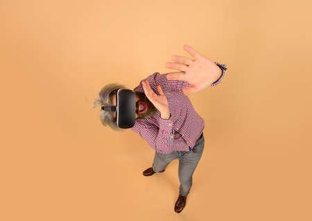 VR. Scared man in virtual reality headset. Future. Future technology concept. Men using VR headset. Virtual reality goggles. Virtual reality. 3d goggles 版權商用圖片