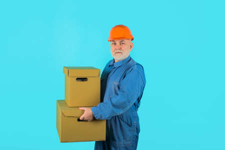 Delivery service, mail, shipment. Delivery e-commerce concept. Delivery man with parcel. Man holds cardboard box. Delivery from shop. Bearded man carry boxes