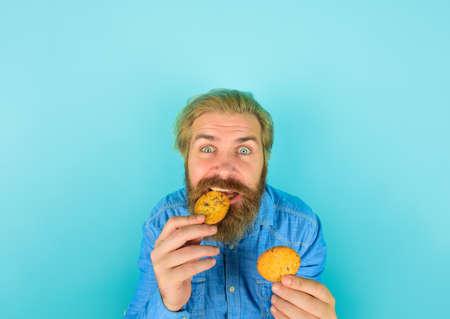 Cookies. Biscuit. Biscuits. Sweet snack. Man eat cookie. Homemade cookies. Bearded man with cookies. Breakfast or lunch. Sweet cookies. Bakery. Taste of childhood
