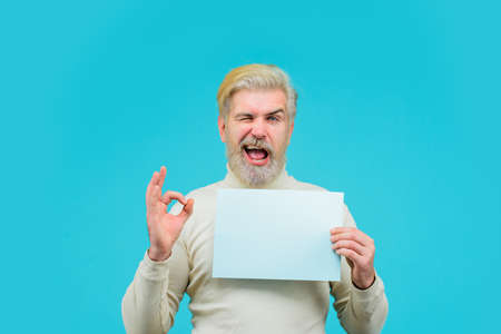 Sale. Discount. Advertising banner. Man with blank board. Man shows sign okay. Space for your text. Bearded man holds empty board. Advertising board. Copy space for text