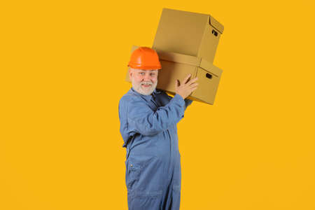 Delivery from shop. Bearded man carry boxes. Delivery service. Shipment. Delivery concept. Delivery man with boxes. Man holds cardboard box