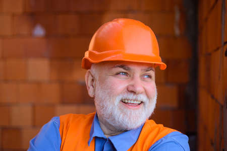 Building, industry, technology. Man in suit with construction helmet. Builder in hard hat. Engineers working. Repairment. Portrait mechanical worker. Construction worker in hardhat 版權商用圖片