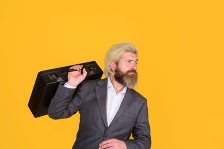 Serious businessman with suitcase. Business. Office worker. CEO. Smiling businessman in suit. Business, people and office concept. Bearded businessman with case. Business growth