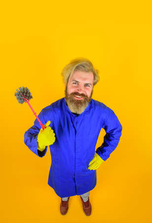 Toilet brush. House cleaning. Man with toilet brush. Cleaning and Disinfection. Professional cleaning. Cleaning service. Clean up. Clearing tools. Household. Housekeeping. Bearded cleaner.