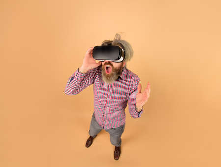 Virtual reality glasses. Scared man in virtual reality headset. 3d goggles. VR. Future technology concept. Men using VR headset. Virtual reality device. Technology
