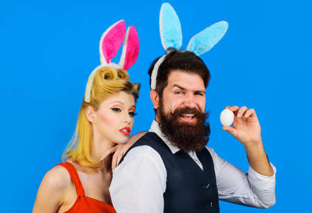 Easter couple. Happy family celebrate Easters. Handsome bearded man and funny woman. Bunny ears. Love.