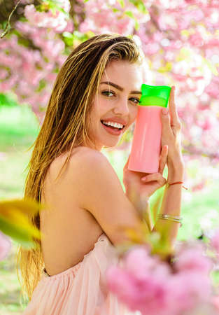 Sexy girl with shampoo, balsam, conditioner. Hair care, skincare and beauty concept. Woman with organic cosmetic. Nature herbal cosmetics.