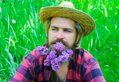 Handsome spring man with beard of flowers. Bearded male with decorated beard. 版權商用圖片