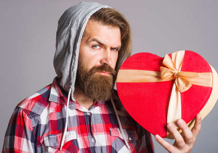 Heart shape. Man with valentines gift. Present with love. Presents and gifts. 版權商用圖片