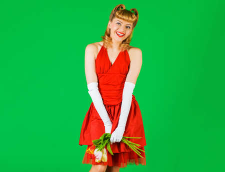 Valentines day. Holidays concept. Pin up girl with tulips. Retro woman with flowers.