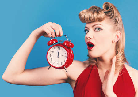 Time. Surprised woman with alarm watch. Pin up girl with alarm clock. 版權商用圖片 - 164432509