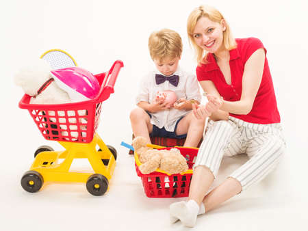 Family relationships. Son with mother plays in shop. Playing supermarket.