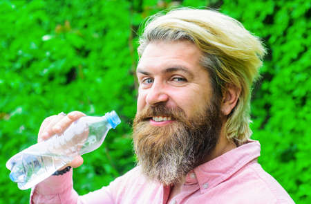Bearded man drinking water. Male with bottle. Healthy lifestyle. Drinks water. Hydration concept. Stay hydrated.